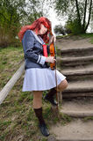Cosplayer with a fiddle Royalty Free Stock Photography