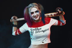 Cosplayer girl with in Harley Quinn costume. Halloween make up Stock Image