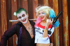 Cosplayer girl in Harley Quinn costume and man in Joker costume Stock Photos