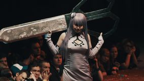 Cosplayer girl showing anime character outfit on stage at festival stock video footage