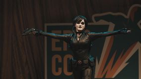 Cosplayer girl showing Domino character costume on scene at festival stock video footage
