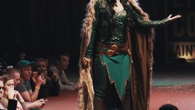 Cosplayer girl showing Loki character costume on scene at festival stock video footage