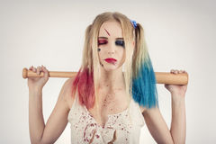 Cosplayer Harley Quinn. Cosplayer girl in Harley Quinn makeup and costume Stock Photo