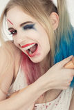 Cosplayer Harley Quinn. Cosplayer girl in Harley Quinn makeup and costume Stock Photos