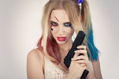 Cosplayer Harley Quinn. Cosplayer girl in Harley Quinn makeup and costume Stock Photography