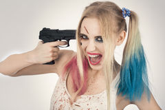 Cosplayer Harley Quinn. Cosplayer girl in Harley Quinn makeup and costume Royalty Free Stock Photography