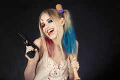Cosplayer Harley Quinn. Cosplayer girl in Harley Quinn makeup and costume Royalty Free Stock Images