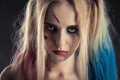Cosplayer Harley Quinn. Cosplayer girl in Harley Quinn makeup and costume Royalty Free Stock Image