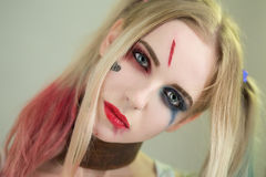 Cosplayer Harley Quinn. Cosplayer girl in Harley Quinn makeup and costume Stock Images