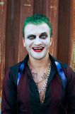 Cosplayer man in Joker costume Royalty Free Stock Photography