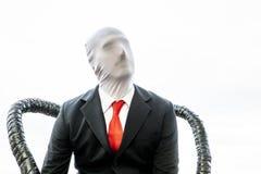 Cosplayer med det röda bandet och den anonyma framsidan royaltyfria foton
