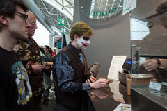 Cosplayer paying for his food at Festival del Fumetto convention in Milan, Italy Royalty Free Stock Photography