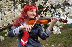 Cosplayer playing the violin Royalty Free Stock Photo