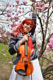 Cosplayer with the violin outdoors Royalty Free Stock Image