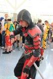 Cosplayers die kostuums en maniertoebehoren dragen in Anime Exp Stock Foto's