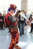 Cosplayers die kostuums en maniertoebehoren dragen in Anime Exp Stock Fotografie