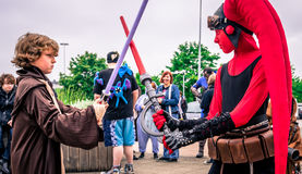 Cosplayers dressed as `Anakin Skywalker` and `Darth Talon` from Stock Photo