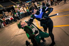 Cosplayers dressed as 'Nightwing' and 'Mad Hatter' from 'Batman' Royalty Free Stock Images