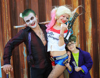 Cosplayers in Harley Quinn costume, in Joker costumes Royalty Free Stock Photos