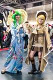 Cosplayers klädde som Vocaloid tecken royaltyfria bilder
