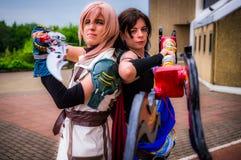 Cosplayers kleidete als ` Blitz ` und ` Reißzahn ` vom ` Final Fantasy an Lizenzfreies Stockbild