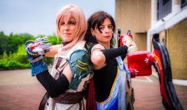 Cosplayers kleidete als ` Blitz ` und ` Reißzahn ` vom ` Final Fantasy an Lizenzfreie Stockfotos