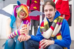Cosplayers at Megacon convention. Carlisle, UK - August 19, 2017: Female cosplayer dressed as My Little Pony and male cosplayer wearing a Tom Baker from Doctor Stock Photography