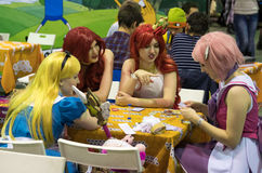 Cosplayers playing table game at the Gamefilmexpo festival Stock Photos