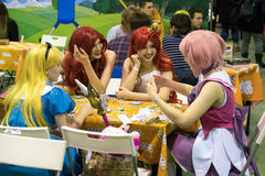 Cosplayers playing table game at the Gamefilmexpo festival Stock Photo