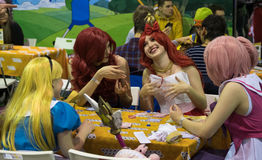 Cosplayers playing table game at the Gamefilmexpo festival royalty free stock photography
