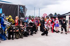 Cosplayers posing for photographers and press Stock Photography