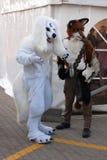 Cosplayers vestiu-se como os lobos dos caráteres levantam em Animefest Fotos de Stock Royalty Free