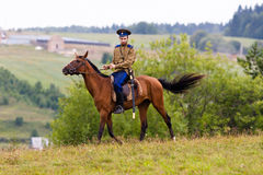 Cossack riding on horseback on the field. Stock Image