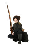 Cossack with rifle in squatting position. Stock Photos