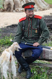 Cossack sits with goat Stock Photography