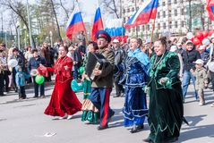 Cossack with women sings songs on procession Stock Photos