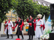 Cossacks sing songs in the town square. Performance with a concert of Cossacks. Russia. Saint-Petersburg. The summer of 2017. Cossacks sing songs in the town Stock Photo