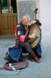 Cossak ucraniano que juega en su bandura Foto de archivo libre de regalías