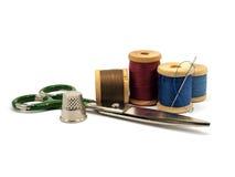 Cosse, pointeau, ciseaux et amorçages Photos stock
