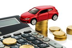 Cost of the car. with calculator. Car and calculator. rising costs for car purchase, lease, workshop, refueling and insurance royalty free stock image