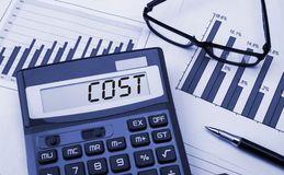 Cost concept. Displayed on calculator Stock Photography