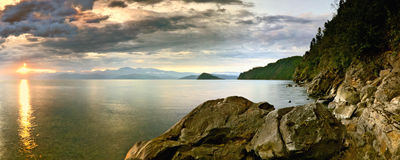 Cost of Dream. Panorama of Sunrise at Baikal royalty free stock photography