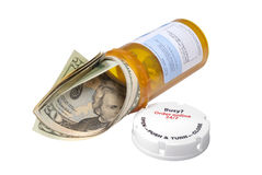 Cost of drugs metaphor, isolated. Cost of prescription drugs metaphor of a prescription bottle with $ 20. bills pouring out Royalty Free Stock Photos