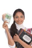 Cost of education student loan and financial aid. Ethnic Indian college student with compositions notebook, copybooks and backpack holds pile 100 (one hundred) Stock Photos