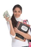 Cost of education student loan and financial aid. Ethnic Indian college student with compositions notebook, copybooks and backpack holds pile 100 (one hundred) Royalty Free Stock Images
