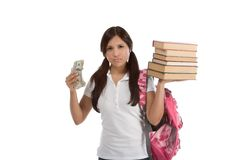 Cost of education student loan and financial aid. Ethnic Hispanic college student with notebook and backpack holds pile 100 (one hundred) dollar bills happy Stock Image