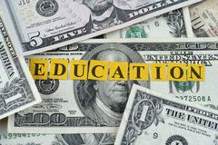 Cost of Education. Word Education on dollar banknotes Stock Image