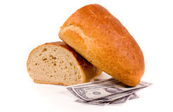 Cost of food. Bread with money against white background royalty free stock images