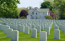 Cost of Freedom. Rows upon rows of white grave markers at a Veteran's Cemetery Stock Images