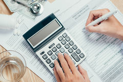 Cost of health care concept, stethoscope and calculator on table Stock Images
